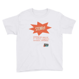 Photograph of a t-shirt product. The t-shirt shown is white with an orange starburst that says STEMist with the definition of STEMist and the Groovy Lab in a Box logo beneath it. The definition reads: STEM•its n. creator, explorer, inventor...STEMist!